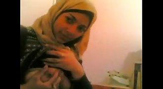 Muslim girl with boyfriend in hotel room